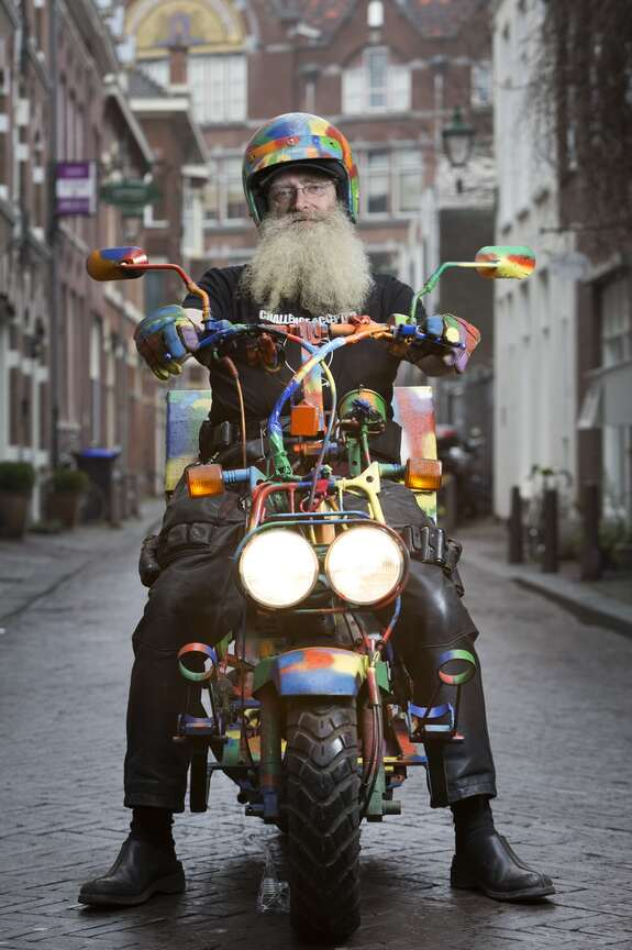 Picture of Aad Bakker (Our Locksmith) on his bike (front view)